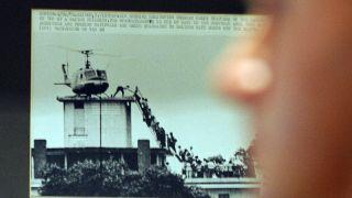 Photographer Hugh Van Es's iconic image of the U.S. evacuation from Saigon, South Vietnam, in April 1975.