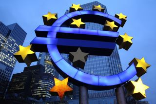 The symbol of the euro, the currency of the eurozone, stands illuminated in Frankfurt on Jan. 21, 2015.