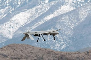 An MQ-1B Predator unmanned aircraft system (UAS) flies during training April 16, 2009, at Creech Air Force Base in Indian Springs, Nevada.