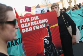 """A sign emblazoned with the words """"For the Liberation of the Woman"""" in German was carried through the streets of Berlin, Germany, during a march International Women's Day in 2015."""