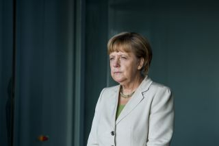 German Chancellor Angela Merkel waits for delegates at a conference on Aug. 28, 2014, in Berlin.
