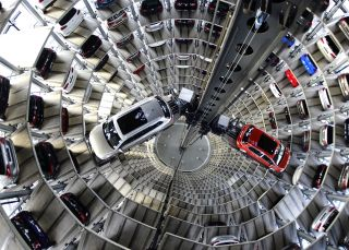Brand new Volkswagen Passat and Golf 7 cars stand stored in a tower at the Volkswagen Autostadt complex in Wolfsburg, Germany.