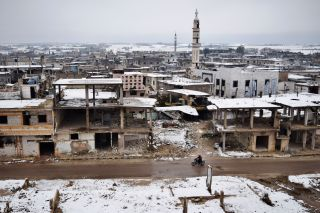 Snow covers the damaged buildings in Homs during December 2016.
