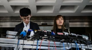 Baggio Leung (l) and Yau Wai-ching, both pro-indpendence lawmakers, were among six representatives barred from taking their seats in Hong Kong's legislature.