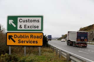A lorry passes a sign on a main road outside Newry, Northern Ireland, on Nov. 14, 2018. The sign points toward an old customs and excise station near the border between Northern Ireland and Ireland.