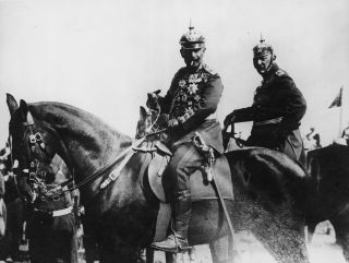 Kaiser Wilhelm II (L), the emperor of Germany and king of Prussia, sits in the field during army maneuvers with Gen. Helmuth von Moltke, circa 1914.
