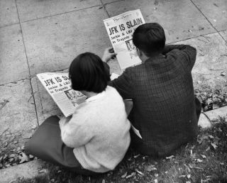 In Washington's Lafayette Square, two people read the news of the president's assassination.