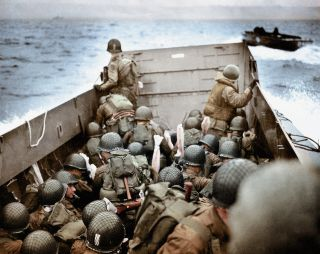 A Landing Craft, Vehicle, Personnel (LCVP) approaches Omaha Beach, Normandy, France, on June 6, 1944. To the right is another LCVP.