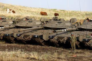 Israeli Merkava Mark IV main battle tanks deployed near the Syrian border in the Golan Heights on May 10, 2018.