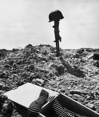 A makeshift monument to a dead American soldier at Normandy, after the D-Day assault on the French coast, June 6, 1944.