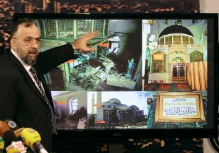 Activists said that government forces shelled the centuries-old mausoleum at the Khaled bin al-Waleed mosque in Homs.