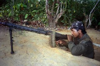 An insurgency group calling itself the Arakan Rohingya Salvation Army attacked police and military outposts on Aug. 25, prompting Myanmar's military to crack down on the Rohingya in response. In 1992, the growth of another group, the Rohingya Solidarity Organization, sparked a crisis with Bangladesh. In this March 1992 photo, a Rohingya fighter guards an outpost on the border.