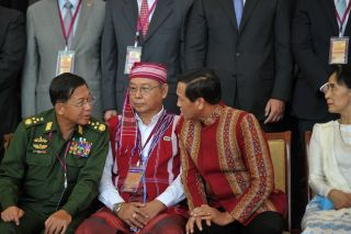 Myanmar's military, which is staging the crackdown on the Rohingya, has massive power in the country. In this photo taken Aug. 31, 2016, Myanmar military commander Senior Gen. Min Aung Hlaing, left, speaks with Vice President Henry Van Thio as de facto leader Aung San Suu Kyi looks on.