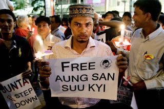 Rohingya activists rallied against the Myanmar military during its longtime dictatorship. An ethnic Rohingya dissident participates in an October 2007 candlelight vigil demanding the release of Aung San Suu Kyi, the democratic icon who largely has been silent about the Rohingya.