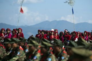 Myanmar is home to a host of insurgent groups claiming to represent the interests of ethnic minorities. Some are aligned with the central government, others are negotiating for power and still others are engaged in active fighting. This Jan. 12, 2014, photo shows Ta'ang National Liberation Army fighters on parade in Shan State.