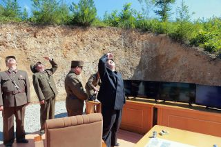 Kim Jong Un, with his usual entourage of generals, watches the successful test-firing of the Hwasong-14 ballistic missile, July 4.
