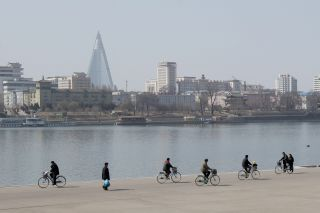 A view of downtown Pyongyang, the capital city of North Korea, dominated by the unfinished Ryugyong Hotel.