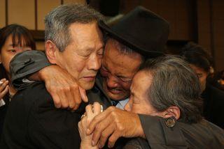 Son Gwon-Geun, a native North Korean, weeps as he says goodbye to his South Korean relatives.