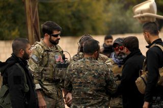 Members of the Syrian Democratic Forces and U.S. personnel gather in the Kurdish-held town of Darbasiyah in northeastern Syria bordering Turkey on Nov. 4, 2018.