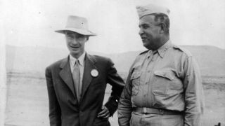 Nuclear physicist J. Robert Oppenheimer with Maj. Gen. Leslie Groves at the Trinity shot tower, from which an atom test bomb was ignited at Los Alamos, New Mexico.