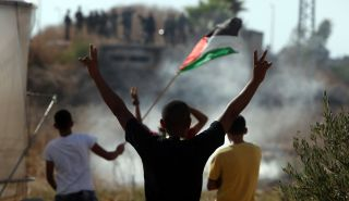 Palestinians protest in the West Bank Palestinian town of Tulkarm during October 2015.