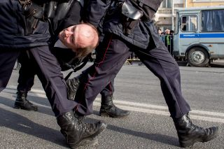 A protestor is carried away by Russian police during an unauthorized rally in central Moscow on March 26.