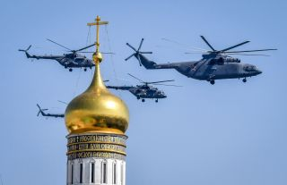 Mi-8 and Mi-26 helicopters fly over Moscow. Russia is known for its transport helicopters, which are used throughout the world.