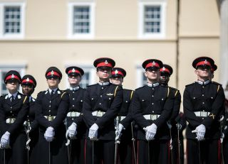 Crown Prince Hussein bin Abdullah (center) stands at ease during the Commissioning Parade at the Royal Military Academy Sandhurst, Aug. 11, 2017.