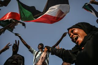 Sudanese citizens protest outside the military's headquarters in Khartoum on April 30, 2019 to push for a civilian-led transition after the ousting of President Omar al Bashir.