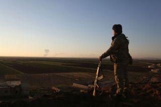 Smoke billows from Afrin.