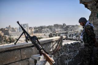 An SDF member stands guard in Raqqa.