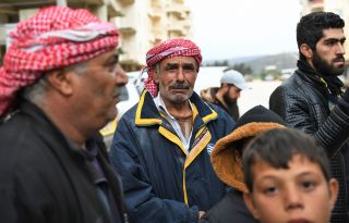 Syrians who fled Jandairis arrive in Afrin city Jan. 25.