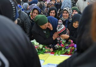 Syrian women attend a funeral for civilians and military personnel killed during the operation in Afrin.