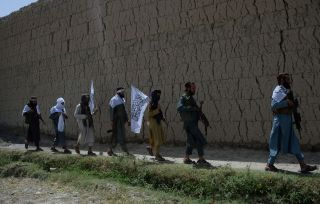 Afghan Taliban militants took to the street to celebrate an unprecedented cease-fire on the second day of Eid in the outskirts of Jalalabad, June 16, 2018.