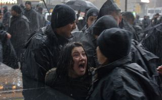 A woman in Ankara, Tukey, yells at riot police while they attempt to detain her at a women's rights rally in 2018.