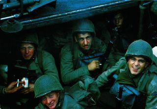 U.S. Army Rangers of E Company, 5th Ranger Battalion, wait aboard a landing craft in Weymouth harbor, Dorset, June 4, 1944.