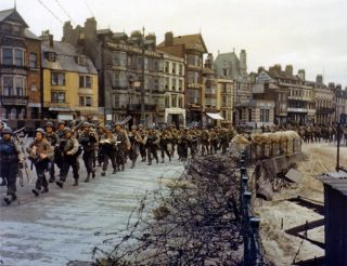 U.S. troops ready to board landing ships at Weymouth, England for the D-Day Normandy Invasion 1944.