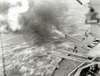 The guns of the battleship USS Nevada (BB-36) in action on the morning of June 6, 1944.