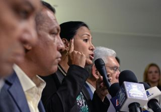Laidy Gomez, center, a member of Venezuela's political opposition and the newly elected governor of Tachira state, speaks at a press conference on Oct. 24.