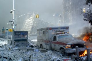 An ambulance, covered with debris, burns after the collapse of the first World Trade Center tower on Sept. 11, 2001, in New York.